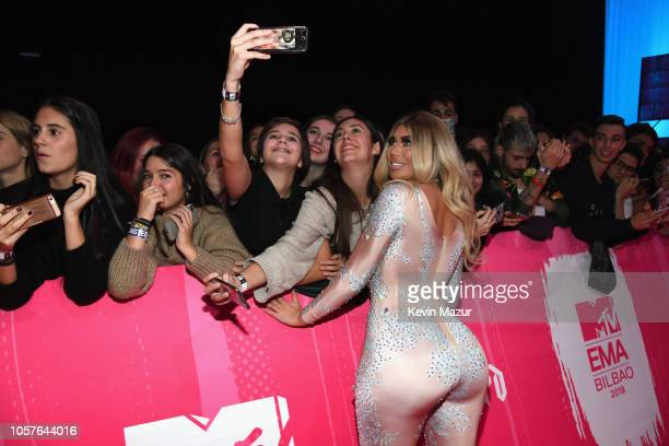 Chloe Ferry takes a selfie with fans as she attends the MTV EMAs 2018 on November 4 2018 in Bilbao Spain
