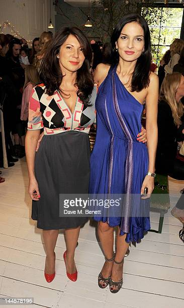 Chloe Franses and Yasmin Mills attend the launch of the Natalia Dress inspired by Natalia Vodianova to benefit her Naked Heart Foundation at Caramel...