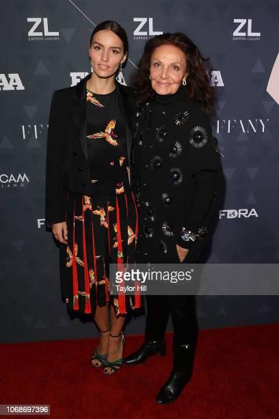Chloe Gosselin and Diane Von Furstenberg attend the 2018 Footwear News Achievement Awards at IAC Headquarters on December 4, 2018 in New York City.
