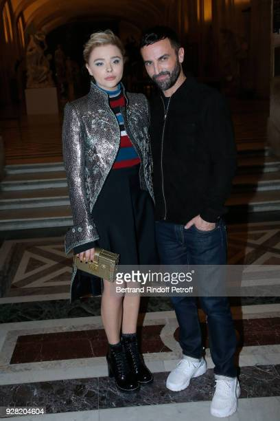 Chloe Grace Moretz and Stylist Nicolas Ghesquiere pose after the Louis Vuitton show as part of the Paris Fashion Week Womenswear Fall/Winter...