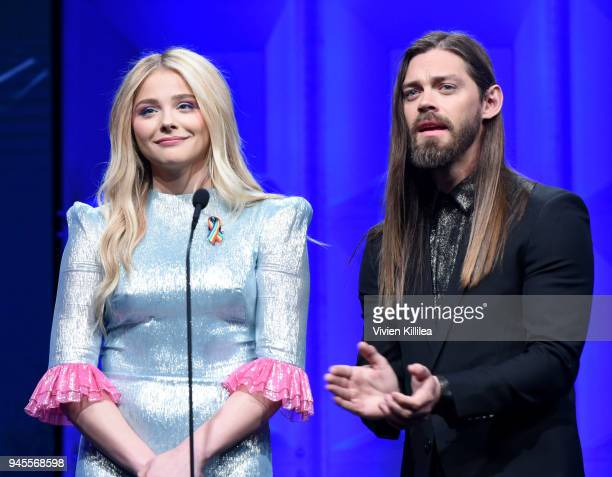 Chloe Grace Moretz and Tom Payne speak onstage at the 29th Annual GLAAD Media Awards at The Beverly Hilton Hotel on April 12 2018 in Beverly Hills...