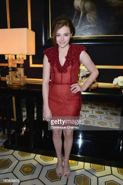 Chloe Grace Moretz attends the HM Fashion Show Fall/Winter 2013 ReadytoWear show as part of Paris Fashion Week on February 27 2013 in Paris France