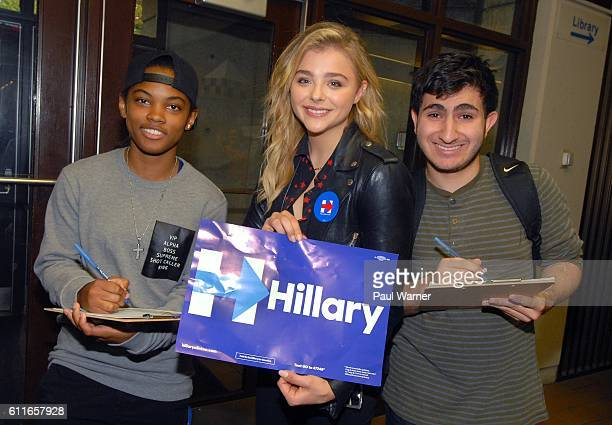 Chloe Grace Moretz poses with Jazmin Baylis and Tyler AlHamando as they register to vote during a voter registration event in support of Hillary...