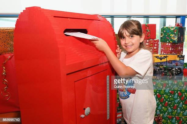 Chloe Guidera post a letter in a letterbox made out of LEGO at Chadstone Shopping Centre on December 2 2017 in Melbourne Australia The special...