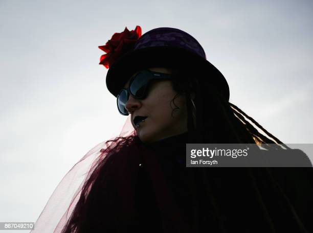 Chloe Hardy from Inverness looks over the town as she attends the Whitby Goth Weekend on October 27, 2017 in Whitby, England. The Whitby Goth Weekend...