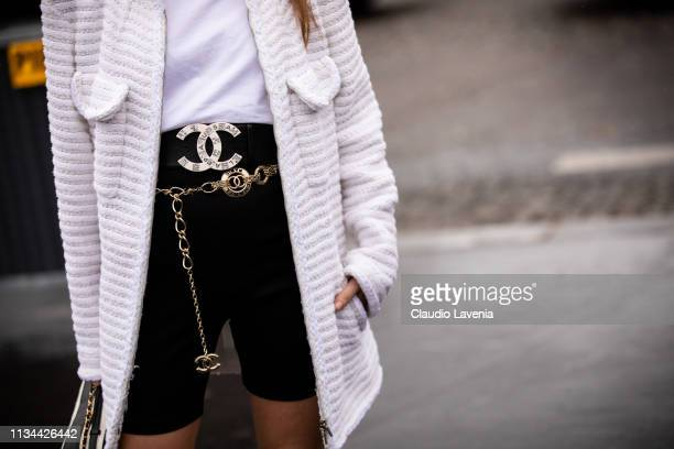 Chloe Harrouche Chanel belts details is seen outside Chanel on Day 9 Paris Fashion Week Autumn/Winter 2019/20 on March 5 2019 in Paris France