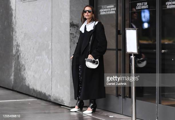Chloe Harrouche is seen wearing a black coat and Chanel outfit outside the Dion Lee show during New York Fashion Week A/W20 on February 10 2020 in...