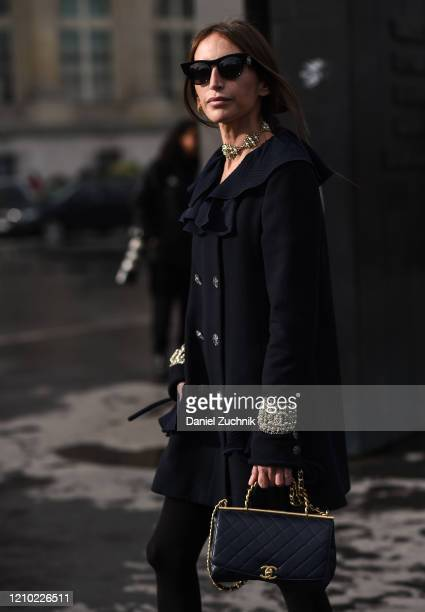 Chloe Harrouche is seen wearing a Chanel dress with purse outside the Chanel show during Paris Fashion Week: AW20 on March 03, 2020 in Paris, France.