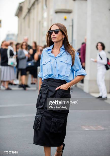 Chloe Harrouche is seen wearing black sirt Prada with pockets, blue button shirt, bag outside the Prada show during Milan Fashion Week Spring/Summer...