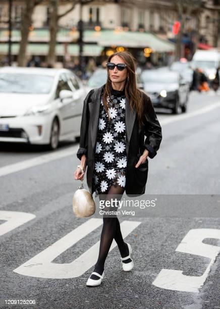 Chloe Harrouche is seen wearing black white dress, sheer tights, black blazer outside Paco Rabanne during Paris Fashion Week - Womenswear Fall/Winter...