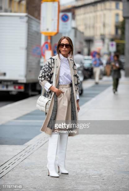 Chloe Harrouche is seen wearing cardigan with print, beige shorts, white Bottega Veneta cross body bag, white boots outside the Max Mara show during...