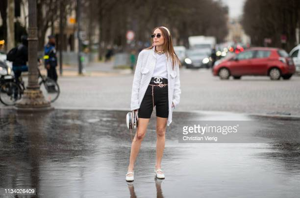 Chloe Harrouche is seen wearing coat shorts belt outside Chanel during Paris Fashion Week Womenswear Fall/Winter 2019/2020 on March 05 2019 in Paris...
