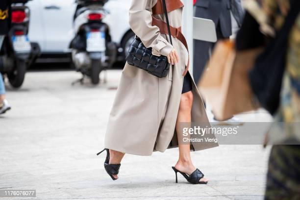 Chloe Harrouche seen wearing beige brown two tone coat black Bottega Veneta cross body bag and shoes LIDO PS20 outside the Sportmax show during Milan...