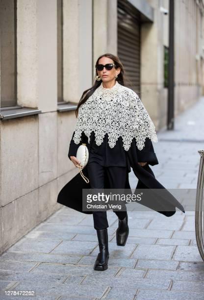 Chloe Harrouche seen wearing black coat, cape, pants, white bag outside Paco Rabanne during Paris Fashion Week - Womenswear Spring Summer 2021 : Day...