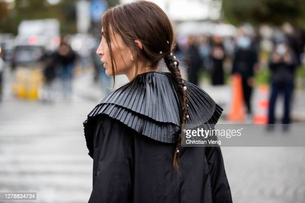 Chloe Harrouche seen wearing black coat, hair clip, pearls outside Chanel during Paris Fashion Week - Womenswear Spring Summer 2021 : Day Nine on...