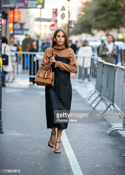 Chloe Harrouche seen wearing brown Boyy bag outside Koche show during Paris Fashion Week Womenswear Spring Summer 2020 on September 24 2019 in Paris...