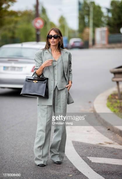 Chloe Harrouche seen wearing suit, black Hermes bag outside Hermes during Paris Fashion Week - Womenswear Spring Summer 2021 : Day Six on October 03,...