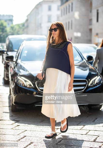 Chloe Harrouche seen wearing white pleated skirt, navy cropped top outside the Pucci during Milan Fashion Week Spring/Summer 2020 on September 19,...