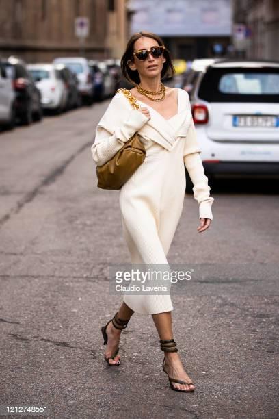Chloe Harrouche, wearing a cream knitted midi dress, brown bag and snakeskin print heels, is seen outside Max Mara show, during Milan Fashion Week...