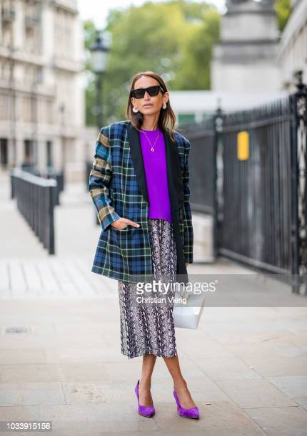 Chloe Harrouche wearing purple knit skirt with slit checked blazer is seen outside Anya Hindmarch during London Fashion Week September 2018 on...