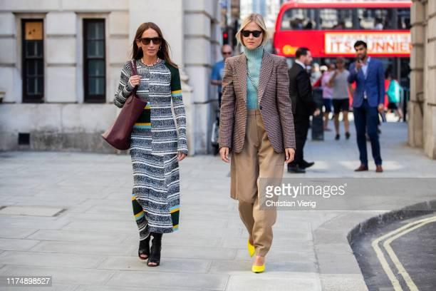Chloe Harrouche wearing striped dress and Linda Tol wearing beige pants, checkered blazer seen outside Victoria Beckham during London Fashion Week...