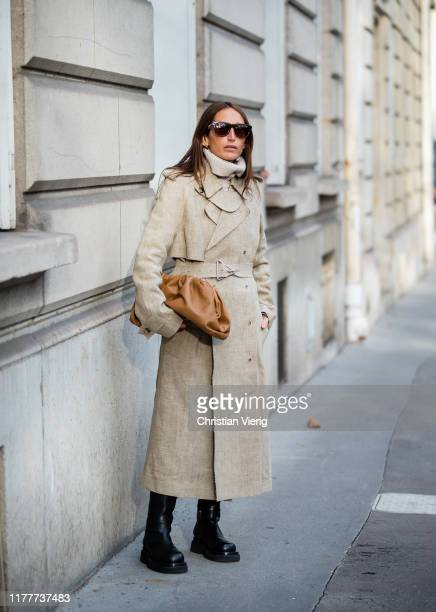 Chloe Harrouche wearing trench coat, brown Bottega Veneta bag, boots outside Alessandra Rich during Paris Fashion Week Womenswear Spring Summer 2020...