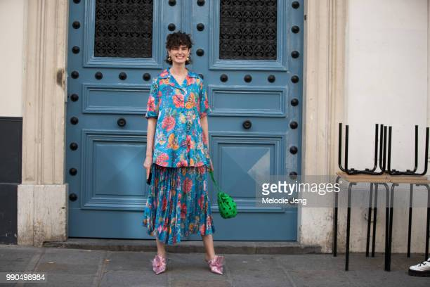 Chloe Hill wears a floral blue Romance Was Born outfit Ganni green bag and Midnight 00 shoes by Ada Kokosar during Couture Fall 2018 Fashion Week on...