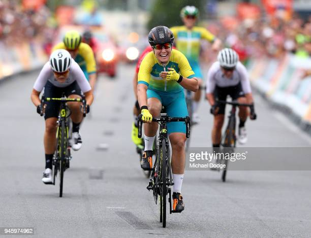 Chloe Hosking of Australia celebrates victory in the Women's Road Race on day 10 of the Gold Coast 2018 Commonwealth Games at Currumbin Beachfront on...