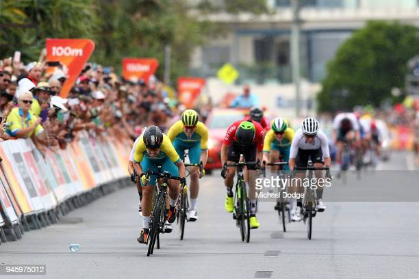 Chloe Hosking of Australia leads the field to the finish line during the Women's Road Race on day 10 of the Gold Coast 2018 Commonwealth Games at...