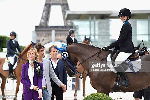 Chloe Hymowitz poses with Virginie CouperieEiffel Richard Orlinski and Charles Berling after she receives the Prize Jappeloup Jumping competition...