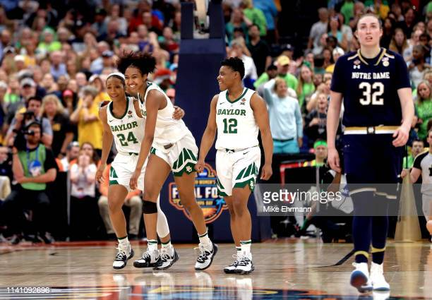 Chloe Jackson, DiDi Richards and Moon Ursin of the Baylor Lady Bears celebrate their teams lead in the final seconds of their teams win as Jessica...