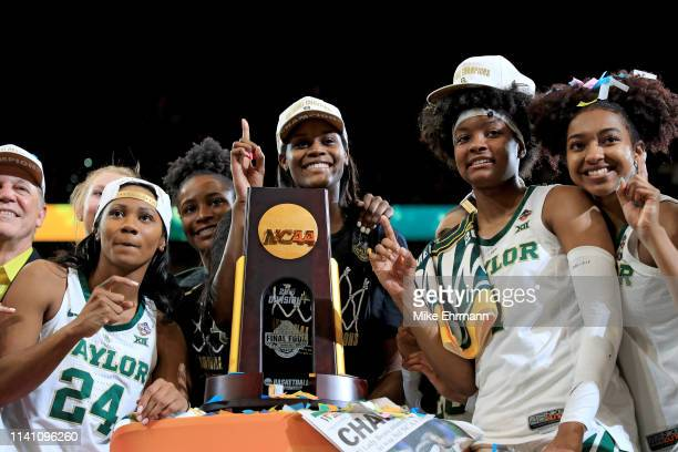 Chloe Jackson Kalani Brown NaLyssa Smith and DiDi Richards of Baylor Lady Bears celebrate with the NCAA trophy after their teams 8281 win over the...