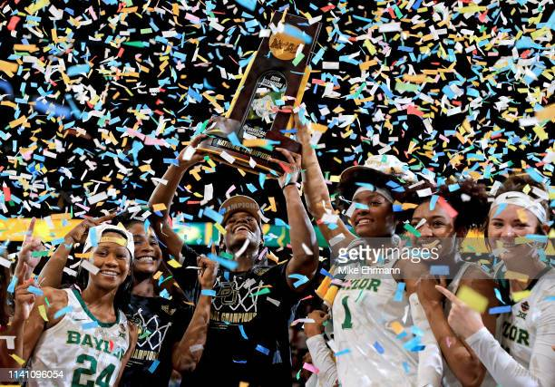 Chloe Jackson Kalani Brown NaLyssa Smith DiDi Richards and Caitlin Bickle of Baylor Lady Bears celebrate with the NCAA trophy after their teams 8281...