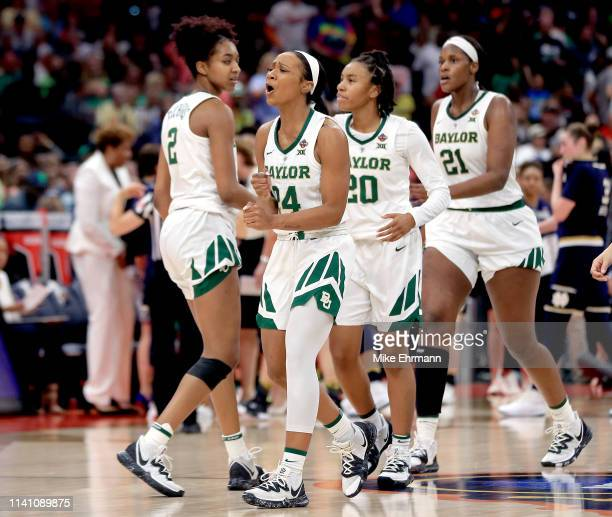 Chloe Jackson of the Baylor Lady Bears celebrates with her teammates after scoring a basket against the Notre Dame Fighting Irish during the fourth...