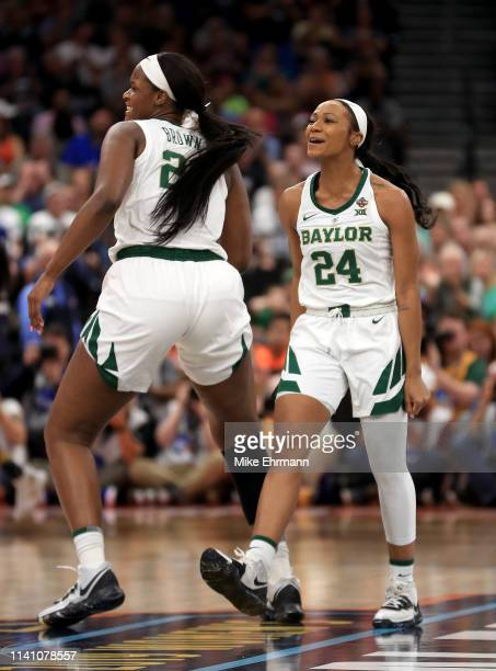 Chloe Jackson of the Baylor Lady Bears is congratulated by her teammate Kalani Brown after scoring a last second basket at the end of the first...
