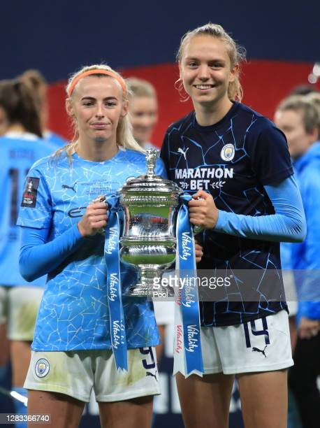 Chloe Kelly and Esme Morgan of Manchester City celebrate with the Vitality Women's FA Cup Trophy following their team's victory in the Vitality...