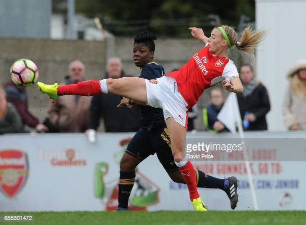 Chloe Kelly of Arsenal controls the ball under pressure from Ertha Pond of Tottenham during the match between Arsenal Ladies and Tottenham Hotspur...