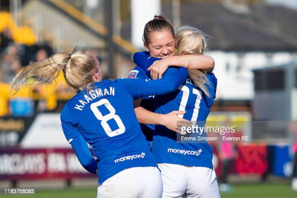 Chloe Kelly of Everton celebrates goal with team mates Lucy Graham and Inessa Kaagman during the Barclays FA Women's Super League match between...