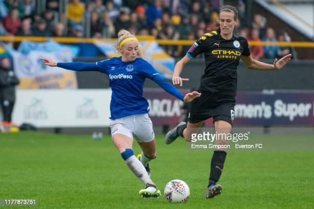 Chloe Kelly of Everton prepares to shoot with watch from Jill Scott of Manchester City during the Barclays FA Women's Super League match between...