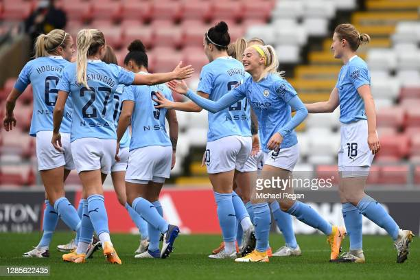 Chloe Kelly of Manchester City celebrates with her team mates after scoring her team's first goal during the Barclays FA Women's Super League match...