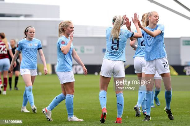 Chloe Kelly of Manchester City celebrates with teammates Laura Coombs, Alex Greenwood and Esme Morgan of Manchester City after scoring their team's...