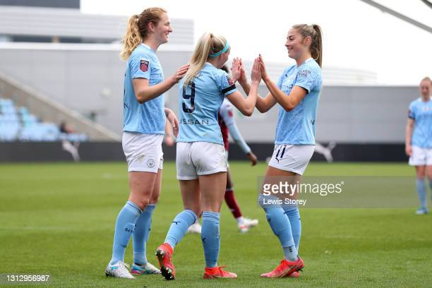 Chloe Kelly of Manchester City celebrates with teammates Sam Mewis and Janine Beckie of Manchester City of Manchester City after scoring their team's...