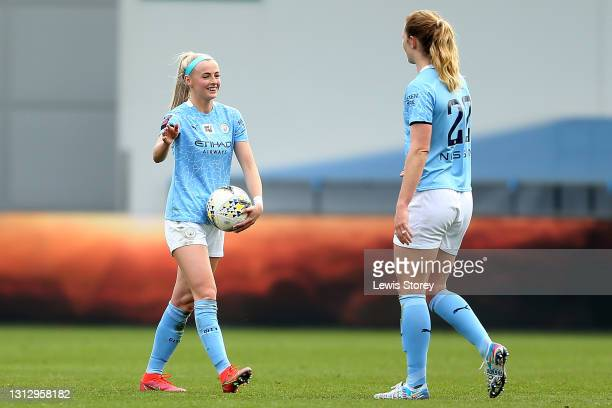 Chloe Kelly of Manchester City is seen carrying the match ball following her hattrick in the match during the Vitality Women's FA Cup Fourth Round...