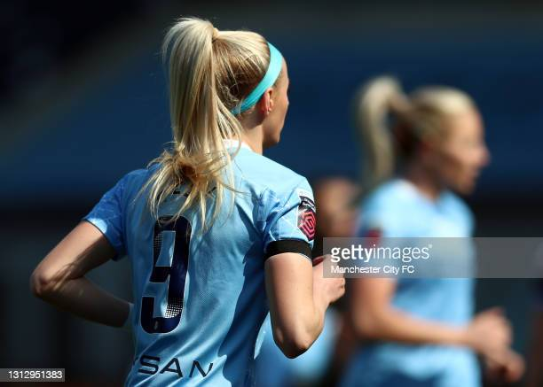 Chloe Kelly of Manchester City is seen wearing a black armband during the Vitality Women's FA Cup Fourth Round match between Manchester City Women...