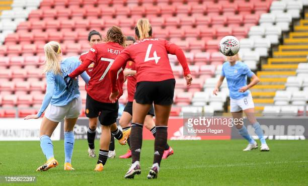 Chloe Kelly of Manchester City scores her team's first goal during the Barclays FA Women's Super League match between Manchester United Women and...