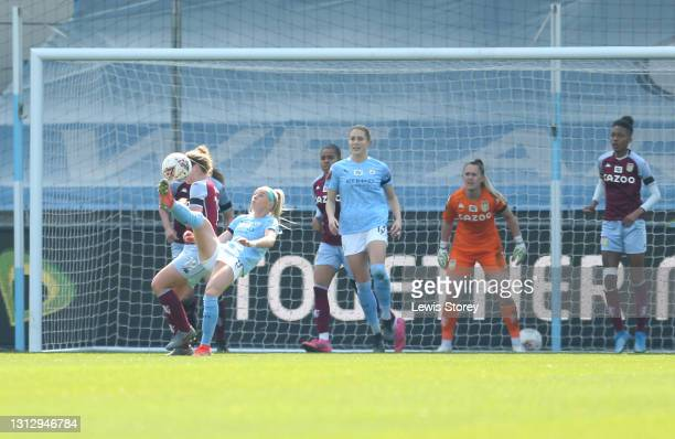 Chloe Kelly of Manchester City scores their team's first goal during the Vitality Women's FA Cup Fourth Round match between Manchester City Women and...