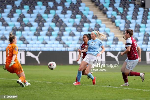 Chloe Kelly of Manchester City scores their team's seventh goal past Sian Rogers of Aston Villa during the Vitality Women's FA Cup Fourth Round match...