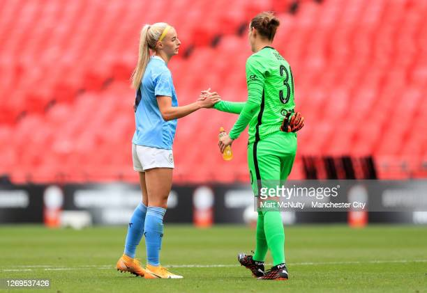 Chloe Kelly of Manchester City shakes hands with Ann-Katrin Berger of Chelsea before the Women's FA Community Shield Final match at Wembley Stadium...