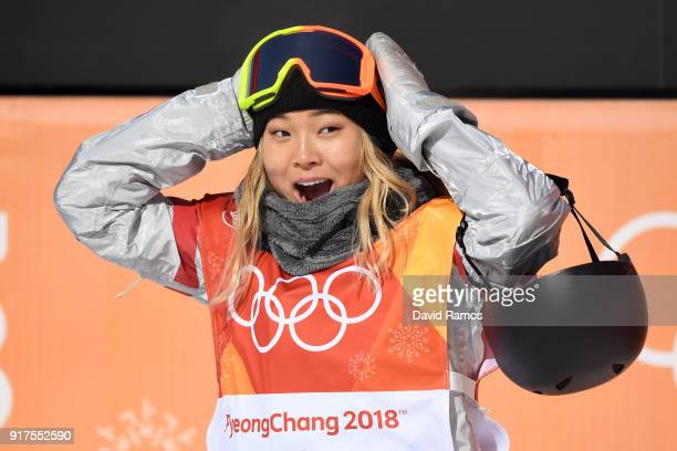 Chloe Kim of the United States reacts to her first run score during the Snowboard Ladies' Halfpipe Final on day four of the PyeongChang 2018 Winter...