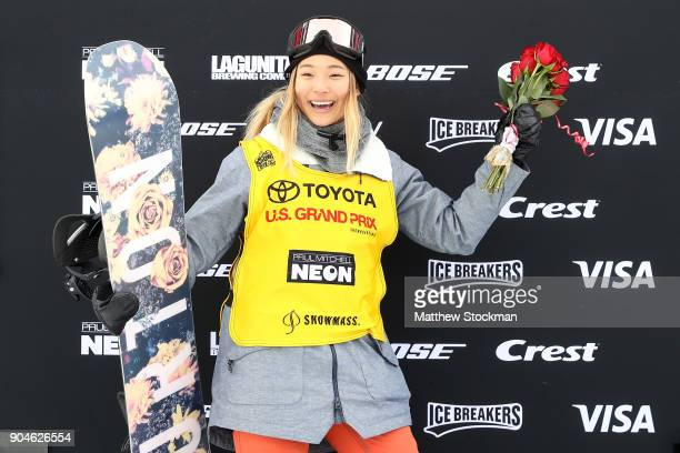 Chloe Kim poses for photographers wearing her FIS points leader's bib after the Ladies Snowboard Halfpipe final during the Toyota US Grand Prix on...